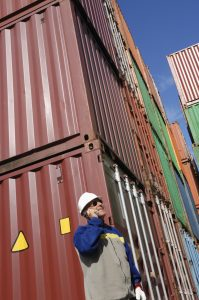 Man standing outside storage container stack